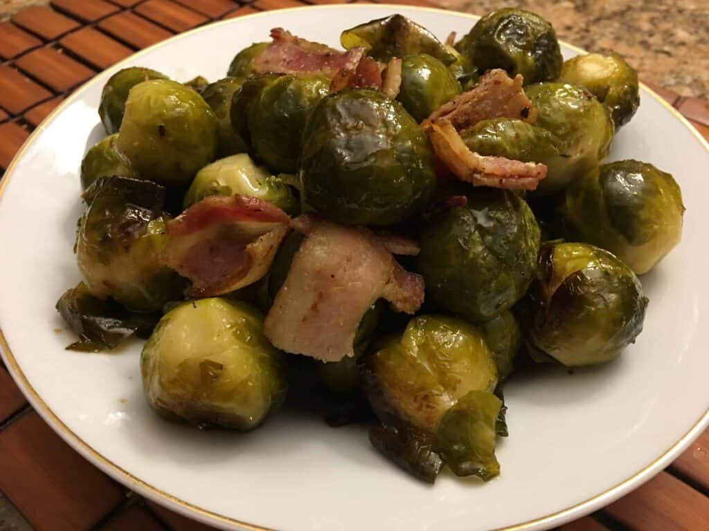 roasted brussel sprouts in a white soup bowl