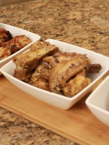 chicken wings in a 3 bowls