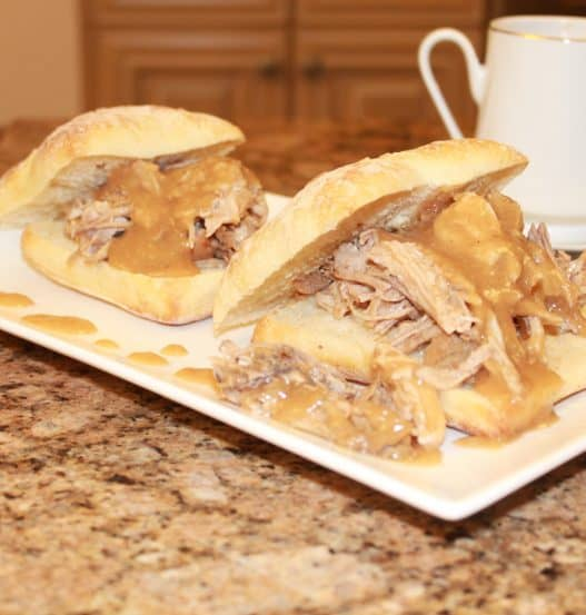 the best pulled pork on a bun on a plate