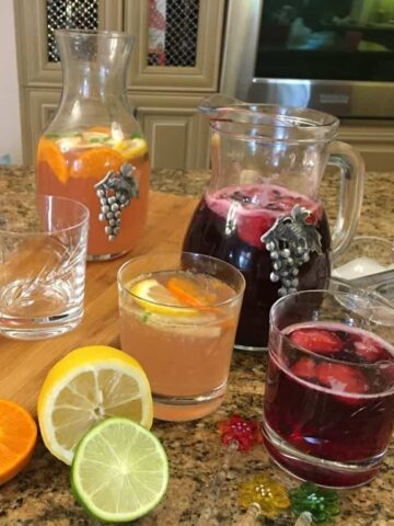 red and white sangria in pitchers
