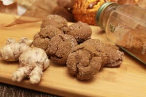 ginger snap cookies on a wooden cutting board