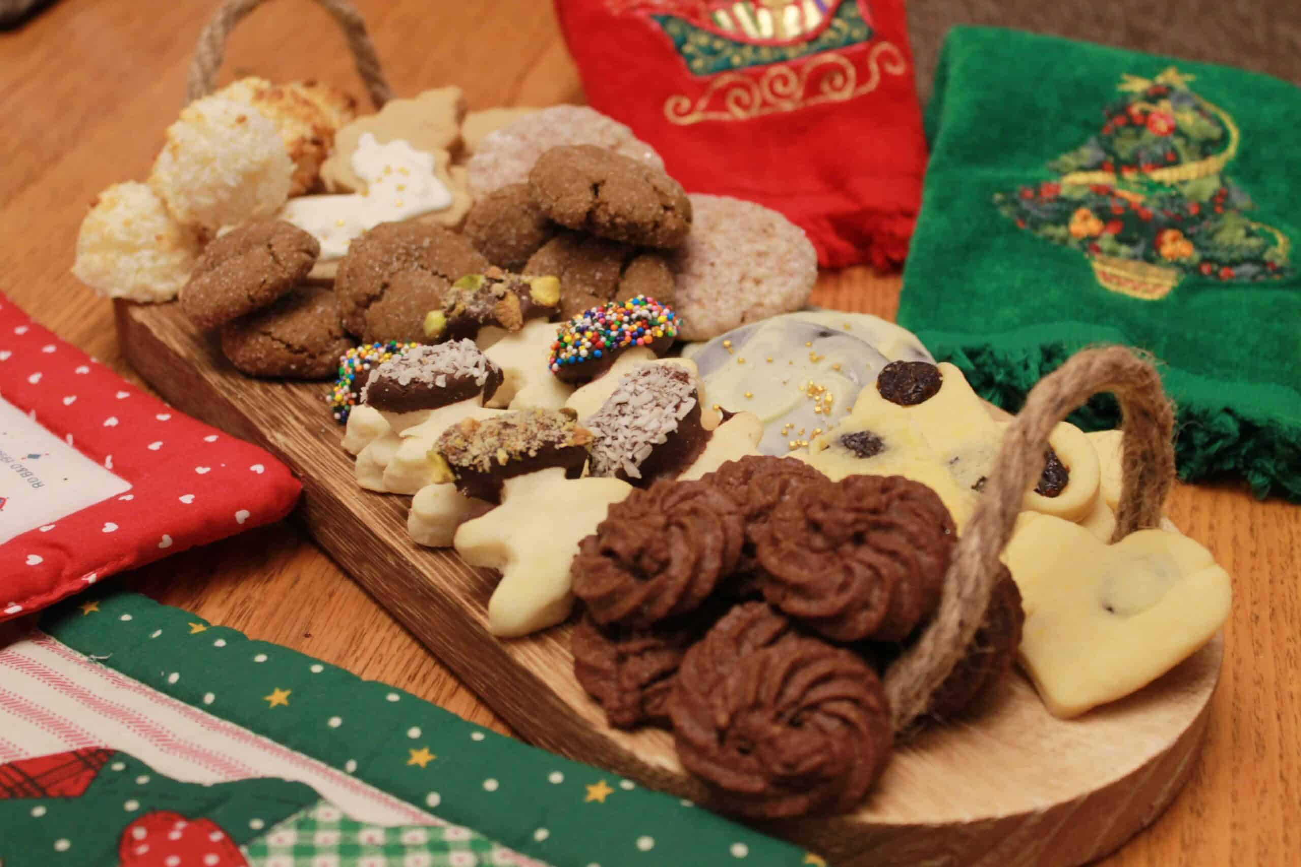 Christmas cookie Recipes on a wooden platter