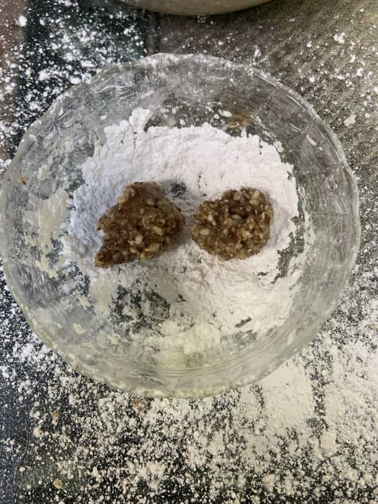 raw amaretto cookies in a bowl