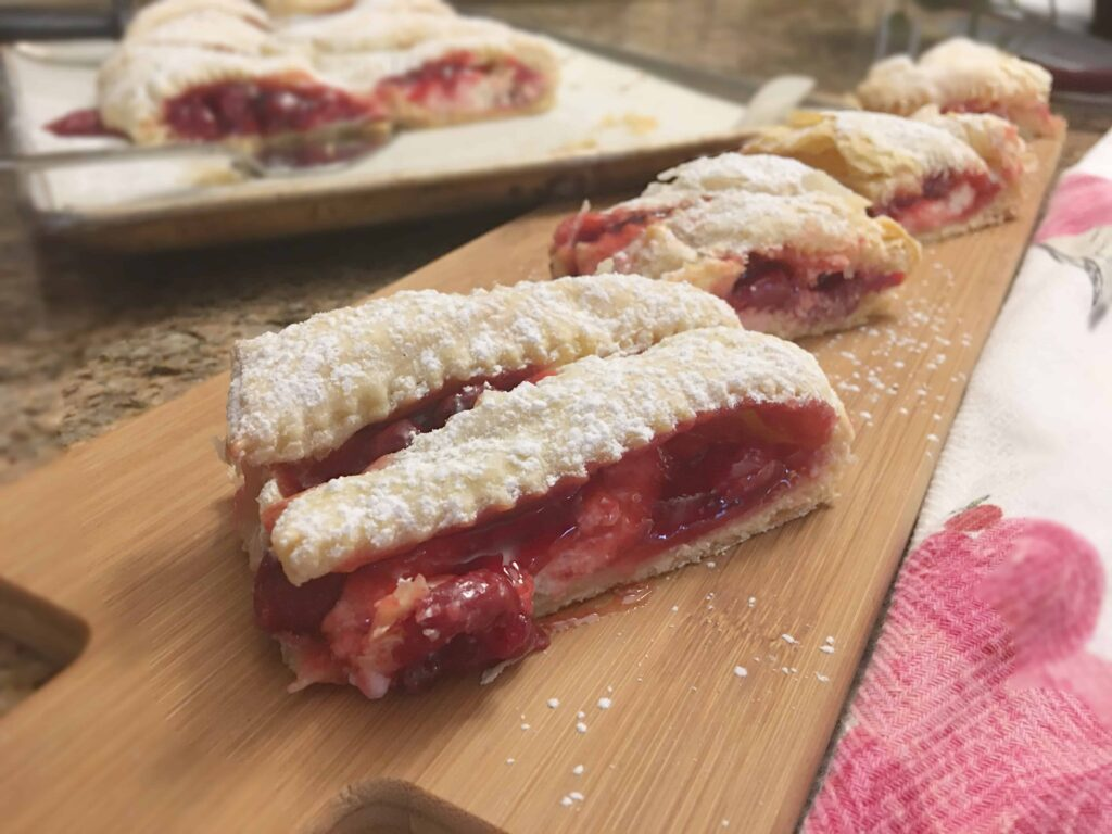 Cherry Strudel on a wooden board