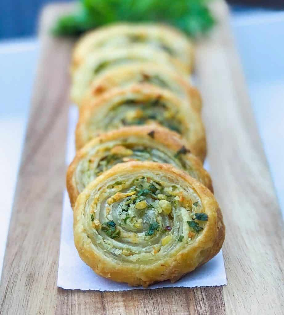 garlic and herb pinwheels on a wooden board