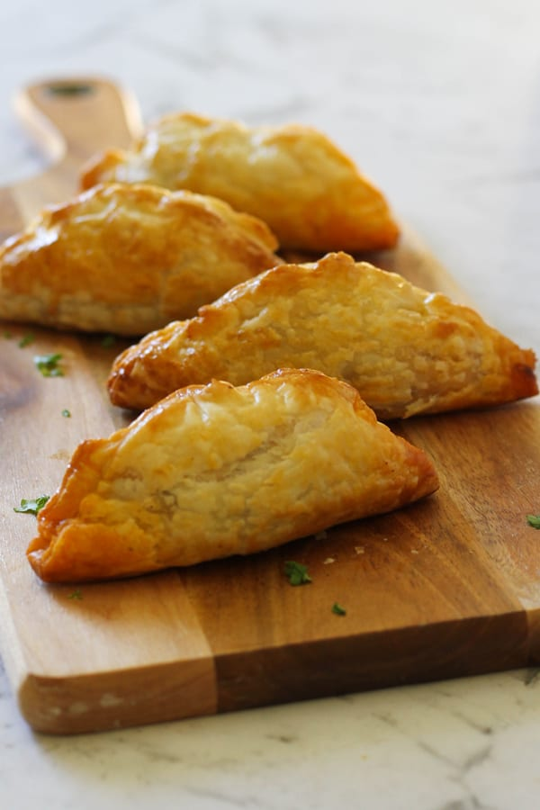 beef pasties on a wooden board