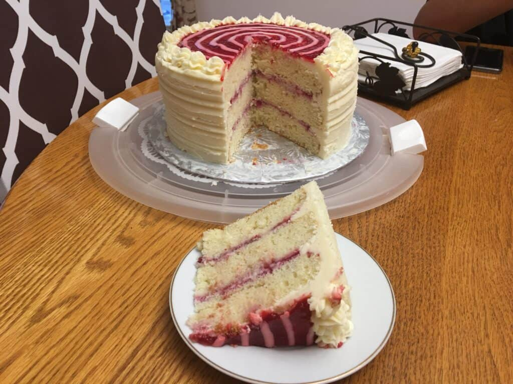 Raspberry White Chocolate Cake in a tray and plate