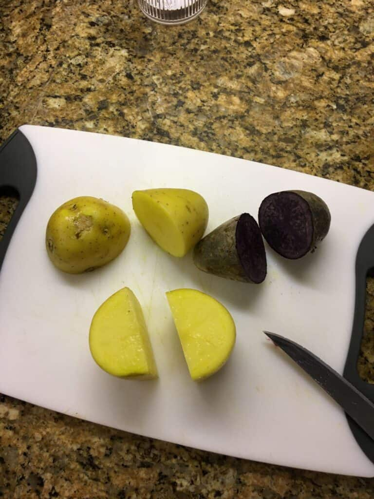 cut potatoes on a cutting board
