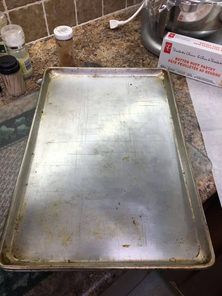 Baking sheet on raw puff pastry