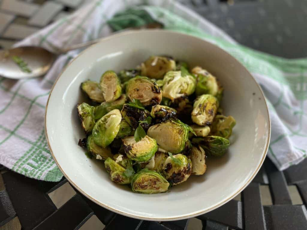 Brussel sprouts in a white bowl