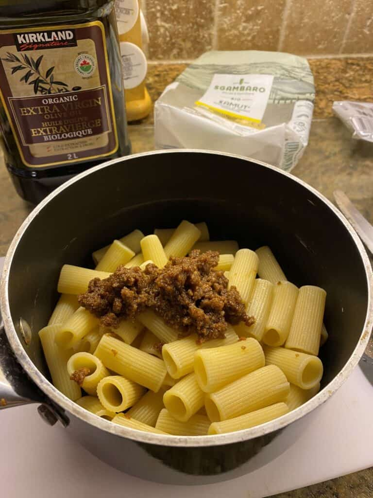 cooked pasta in a pot with seasoning